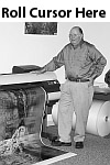 Bill Nordstrom standing next to our 80-inch Canon            giclée printer